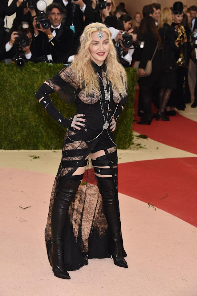 """<p>The Queen of Pop made headlines again in 2016, when she attending the Met Gala in another bottom- and breast-baring ensemble by Givenchy. But the singer stood by her controversial black, lace look and <a href=""""https://www.independent.co.uk/news/people/met-gala-2016-madonna-has-a-message-for-her-critics-a7011276.html"""" rel=""""nofollow noopener"""" target=""""_blank"""" data-ylk=""""slk:shared a message for her fans on Twitter"""" class=""""link rapid-noclick-resp"""">shared a message for her fans on Twitter</a>. <em>[Photo: Getty]</em> </p>"""