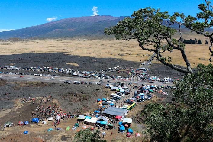 In this July 21, 2019, file photo provided by the Hawaii Department of Land and Natural Resources, protesters block a road to the summit of Mauna Kea in Hawaii. Astronomers across 11 observatories on Hawaii's tallest mountain have cancelled more than 2,000 hours of telescope viewing over the past four weeks because a protest blocked a road to the summit, astronomers said Aug. 9.