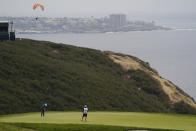 Mackenzie Hughes, of Canada, putts on the third green during the final round of the U.S. Open Golf Championship, Sunday, June 20, 2021, at Torrey Pines Golf Course in San Diego. (AP Photo/Gregory Bull)