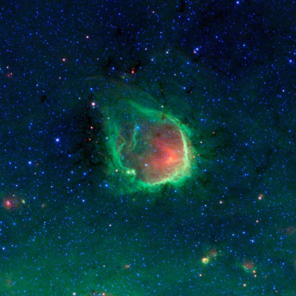 This glowing emerald nebula seen by NASA's Spitzer Space Telescope is named RCW 120; it is about 4,300 light-years away in the tail of the constellation Scorpius. The false-color image was created by assigning brilliant colors to wavelengths that are usually invisible to the human eye. (Photo courtesy Caltech/JPL)