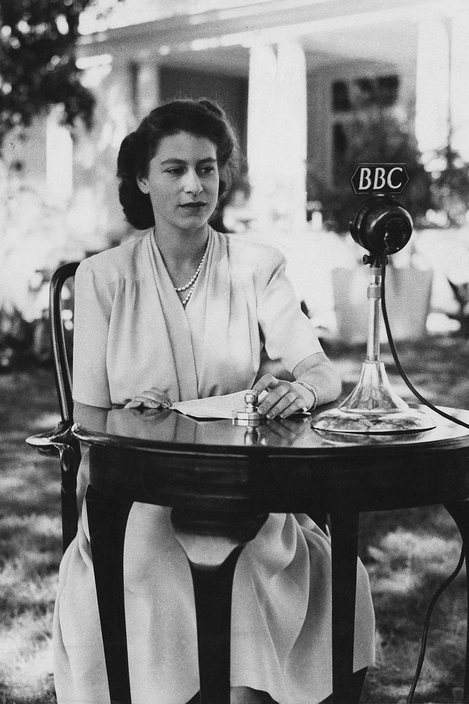 <p>The Princess wore a knee-length dress and pearl necklace when she hopped on the BBC radio to make a broadcast from the gardens of Government House in Cape Town. </p>
