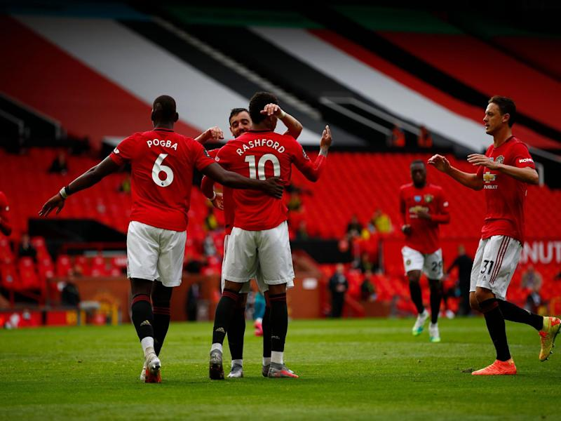 United celebrate after Rashford converts from the spot: Getty