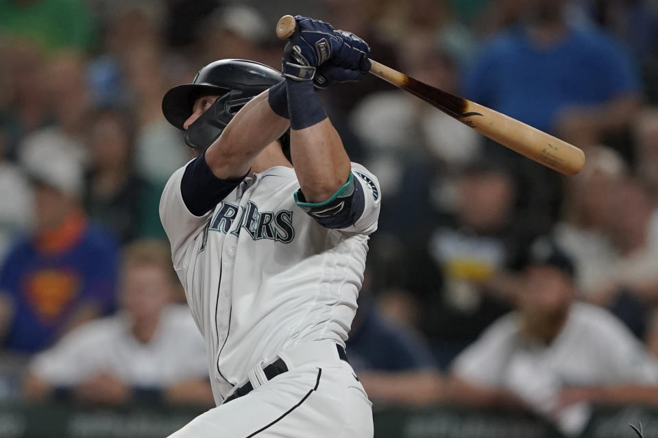 Seattle Mariners' Mitch Haniger watches his two-run home run against the Oakland Athletics during the fifth inning of a baseball game Saturday, July 24, 2021, in Seattle. (AP Photo/Ted S. Warren)
