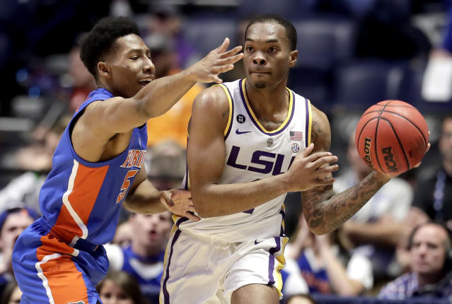 LSU guard Javonte Smart, right, passes away from Florida guard KeVaughn Allen (5) in the first half of an NCAA college basketball game at the Southeastern Conference tournament Friday, March 15, 2019, in Nashville, Tenn. (AP Photo/Mark Humphrey)