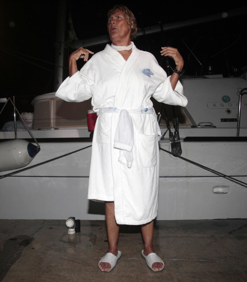 Marathon swimmer Diana Nyad gestures as she talks to friends and reporters at her arrival at Key West, Fla., Sunday, Sept. 25, 2011. Nyad spent more than 40 hours in the shark-filled waters between Cuba and the Florida Keys, climbing into a boat only to be treated for searing welts left by Portuguese man o' war stings. Left swollen and red, Nyad had no choice but to end her trek early when medics warned another sting could be deadly. (AP Photo/Alan Diaz)
