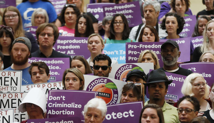 FILE - In this May 16, 2019 file photo, abortion rights supporters stand during a news conference by Presidential candidate Sen. Kirsten Gillibrand, D-N.Y., at the Georgia State Capitol in Atlanta to discuss abortion bans in Georgia and across the country. A federal appeals court plans to hear arguments Friday, Sept. 24, 2021 on whether it should overturn a lower court's ruling that permanently blocks a restrictive abortion law passed in 2019 by Georgia lawmakers. (Bob Andres/Atlanta Journal-Constitution via AP)