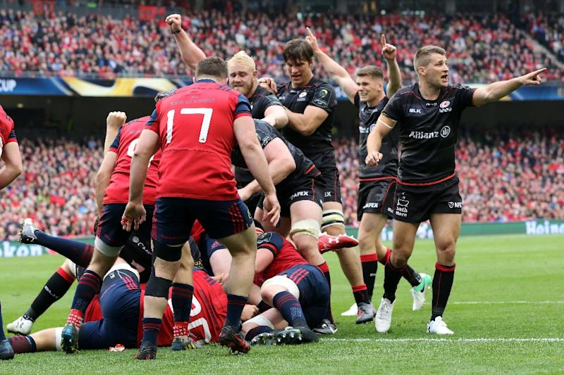 Saracens' players celebrate as Mako Vunipola scores the first try during their rugby union European Champions Cup semi-final match against Munster, at the Aviva stadium in Dublin, on April 22, 2017