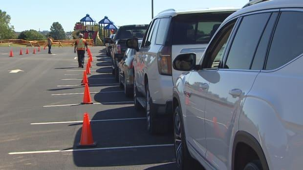 A half hour into Friday's pop-up clinic at West Royalty Elementary the school parking lot was full as parents and students lined up for testing.   (Kirk Pennell/CBC - image credit)