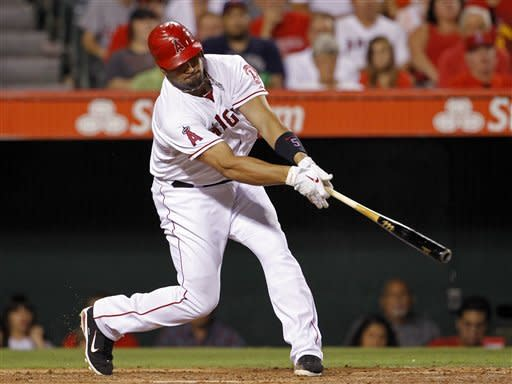 Los Angeles Angels' Albert Pujols connects on a three-run home run against the Cleveland Indians in the fourth inning of a baseball game in Anaheim, Calif., Tuesday, Aug. 14, 2012. (AP Photo/Reed Saxon)