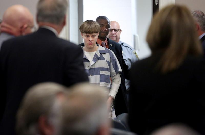 Dylann Roof is escorted into the court room at the Charleston County Judicial Center in Charleston, South Carolina on April 10, 2017.