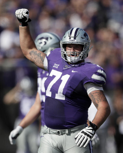 Kansas State offensive lineman Dalton Risner (71) begins to celebrate late in the second half of an NCAA college football game against Oklahoma State in Manhattan, Kan., Saturday, Oct. 13, 2018. Kansas State defeated Oklahoma State 31-12. (AP Photo/Orlin Wagner)