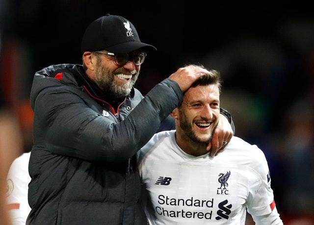 Substitute Adam Lallana (right) saved Liverpool from a chastening loss at bitter rivals Manchester United in a pulsating 1-1 Premier League clash (Martin Rickett/PA)