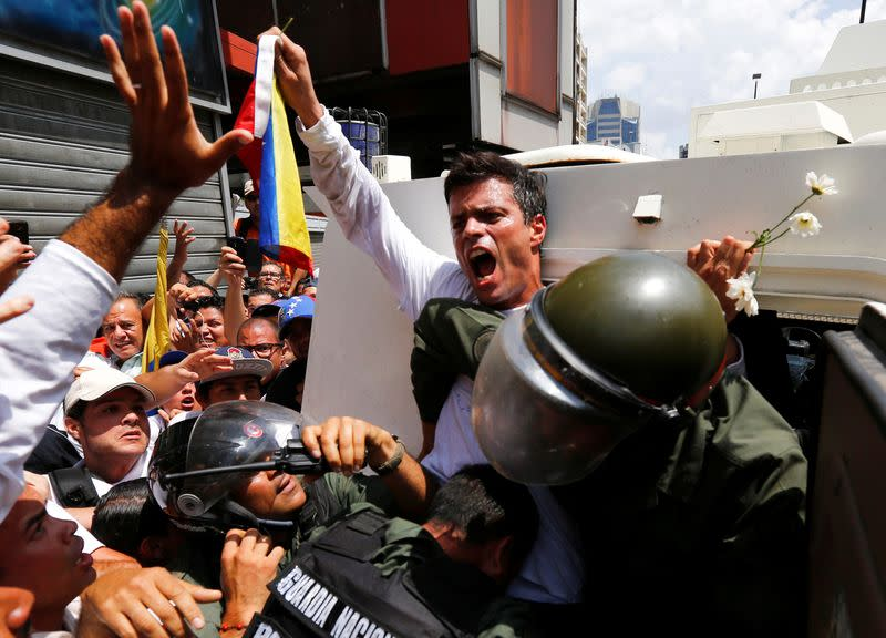 FILE PHOTO: Venezuelan opposition leader Leopoldo Lopez gets into a National Guard armored vehicle in Caracas