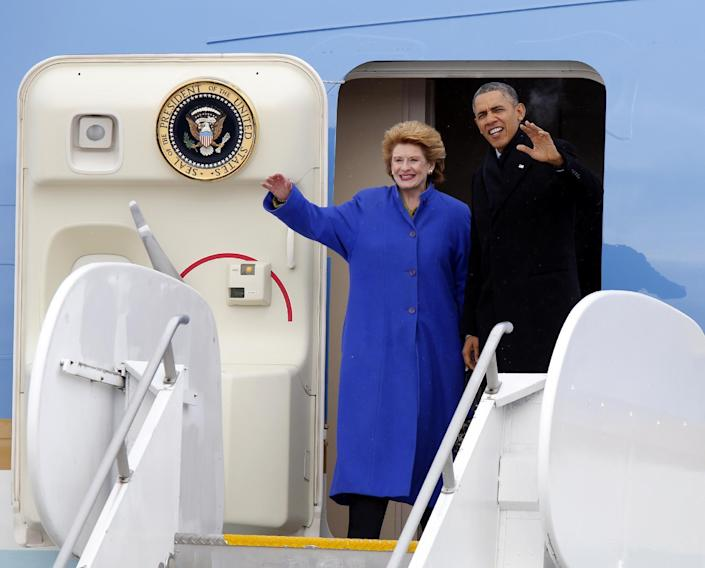 President Barack Obama, and Senate Agriculture Committee Chair Sen. Debbie Stabenow, D-Mich. wave from Air Force One upon their arrival at Capital City Airport in Lansing, Mich., Friday, Feb. 7, 2014. (AP Photo/Duane Burleson)
