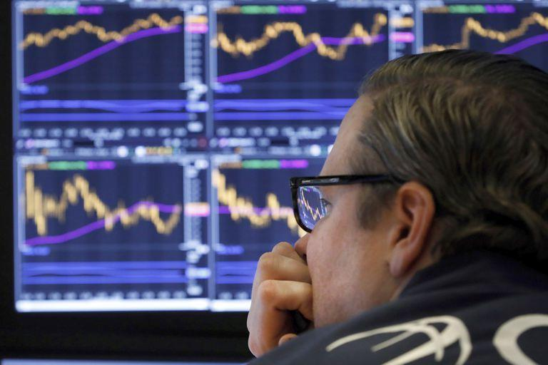 Specialist Gregg Maloney watches the screens at his post on the floor of the New York Stock Exchange, Tuesday, Jan. 28, 2020. Stocks are moving broadly higher on Wall Street in afternoon trading Tuesday, reversing most of the indexes losses from a sell-off the day before.