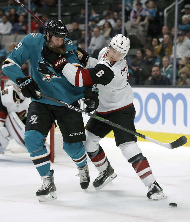 San Jose Sharks' Joe Thornton, left, and Arizona Coyotes' Jakob Chychrun (6) fight for the puck in the first period of an NHL hockey game Tuesday, Dec. 17, 2019, in San Jose, Calif. (AP Photo/Ben Margot)