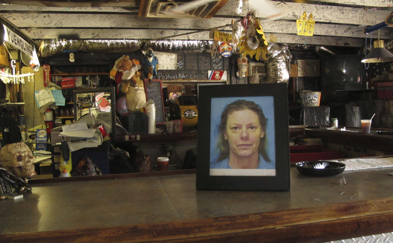In this May 3, 2012 photo, a photo of serial killer Aileen Wuronos sits on the counter at the Last Resort Bar in Port Orange, Fla.  Almost 22 years after Wuornos was arrested at The Last Resort, the curious still come to the place where she had her last drink. (AP Photo/Brendan Farrington)