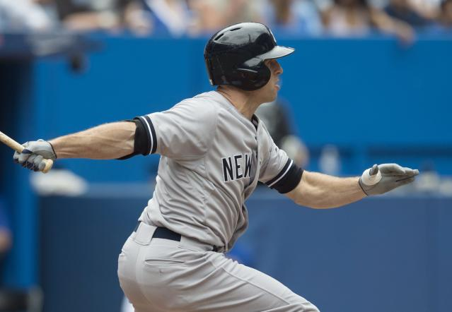 New York Yankees' Brett Gardner hits a triple in the fifth inning of a baseball game against the Toronto Blue Jays in Toronto, Sunday, Aug. 31, 2014. (AP Photo/The Canadian Press, Darren Calabrese)