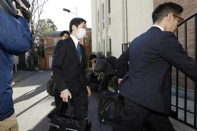 Prosecutors arrive at former Nissan chairman Carlos Ghosn's residence for a raid in Tokyo