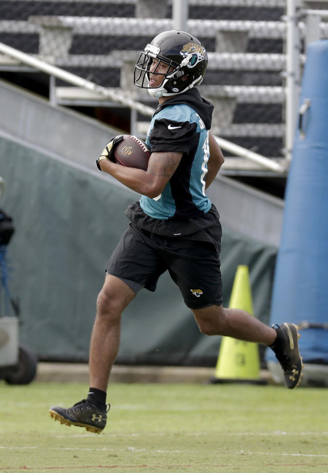 Jacksonville Jaguars wide receiver Rashad Greene runs after a reception during an NFL football practice Wednesday, June 13, 2018, in Jacksonville, Fla. (AP Photo/John Raoux)