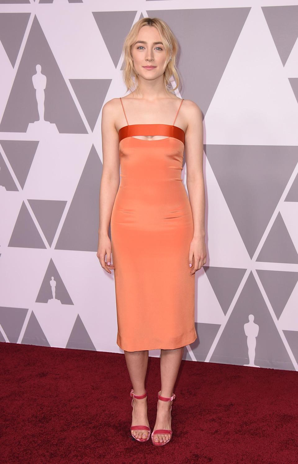 <p>For the luncheon, Saoirse opted for a slinky, paired back Cushnie Et Ochs dress. <em>[Photo: Getty] </em> </p>
