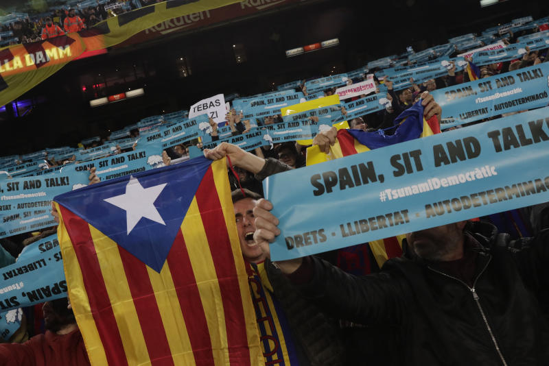 "CORRECT NAME OF THE PHOTOGRAPHER - FC Barcelona's supporters hold an ""estelada"" or independence flag prior of a Spanish La Liga soccer match between Barcelona and Real Madrid at Camp Nou stadium in Barcelona, Spain, Wednesday, Dec. 18, 2019. Thousands of Catalan separatists are planning to protest around and inside Barcelona's Camp Nou Stadium during Wednesday's ""Clasico"". (AP Photo/Bernat Armangue)"