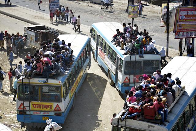 GHAZIABAD, INDIA - MARCH 29: An aerial view of the Lal Kuan bus stand where migrant workers are seen heading to their native state on buses arranged by the Uttar Pradesh government, on Day 5 of the 21 day nationwide lockdown imposed by PM Narendra Modi to curb the spread of coronavirus, on March 29, 2020 in Ghaziabad, India. (Photo by Sakib Ali/Hindustan Times via Getty Images)