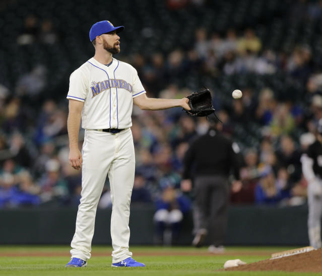 Seattle Mariners relief pitcher Brandon Brennan reaches for the ball during the fifth inning against the Chicago White Sox in a baseball game Sunday, Sept. 15, 2019, in Seattle. Brennan gave up a grand slam to Chicago White Sox's Welington Castillo in the inning. (AP Photo/John Froschauer)
