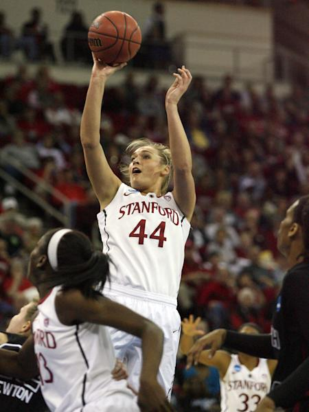 Stanford's Joslyn Tinkle puts a shot up over a South Carolina defender in the first half of an NCAA women's tournament regional semifinal college basketball game Saturday, March 24, in Fresno, Calif. (AP Photo/Gary Kazanjian)