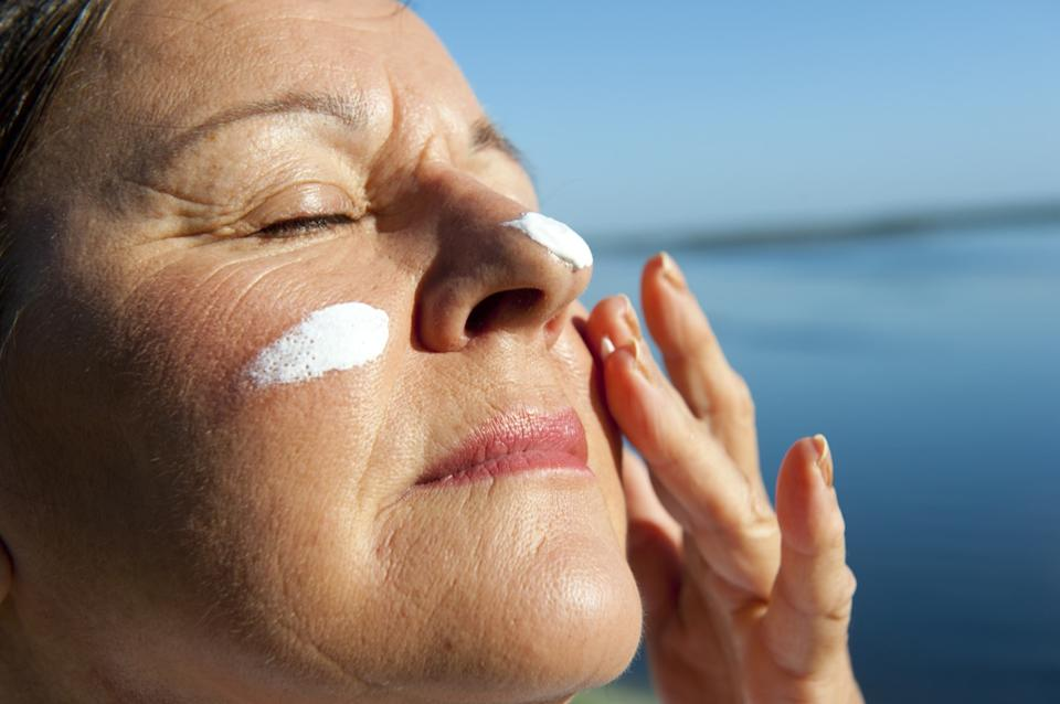 mature woman with suncream on her face