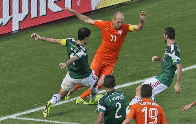 Mexico's Rafael Marquez, left, fouls Netherlands' Arjen Robben inside the penalty box during the World Cup round of 16 soccer match between the Netherlands and Mexico at the Arena Castelao in Fortaleza, Brazil, Sunday, June 29, 2014. (AP Photo/Themba Hadebe)