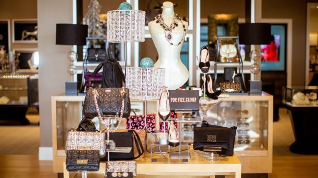 This Nov. 18, 2013, photo, shows Leigh's, an upscale independent clothing retail in Grand Rapids, Mich. Leigh's plans five parties including one Black Friday and another aimed at men shopping for wives and girlfriends. (AP Photo/Adam Bird)