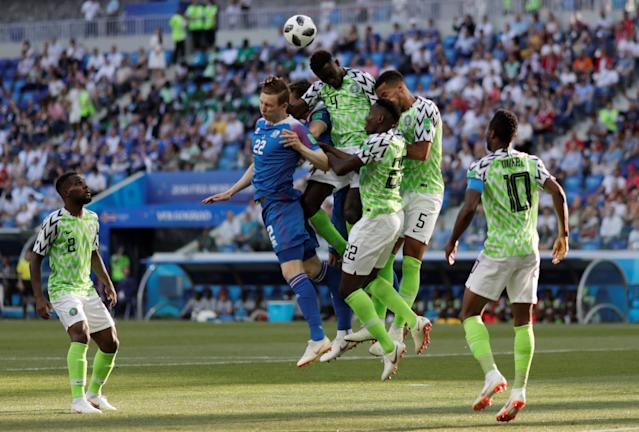 Soccer Football - World Cup - Group D - Nigeria vs Iceland - Volgograd Arena, Volgograd, Russia - June 22, 2018 Iceland's Jon Dadi Bodvarsson in action with Nigeria's Wilfred Ndidi, Kenneth Omeruo and William Troost-Ekong REUTERS/Ueslei Marcelino