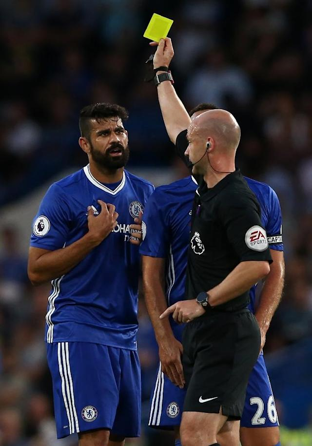 Chelsea's Diego Costa (L) receives a yellow card from referee Anthony Taylor during their English Premier League match against West Ham United, at Stamford Bridge in London, on August 15, 2016 (AFP Photo/Justin Tallis)