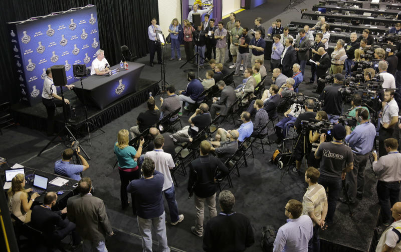 Los Angeles Kings coach Darryl Sutter, top left, answers questions from the media during a news conference at the NHL hockey Stanley Cup finals, Tuesday, June 5, 2012, in Los Angeles. The Kings lead the New Jersey Devils 3-0 in the best-of-seven games series. Game 4 is scheduled for Wednesday. (AP Photo/Julie Jacobson)
