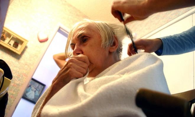 A resident of a California Alzheimer's and dementia facility gets a haircut.