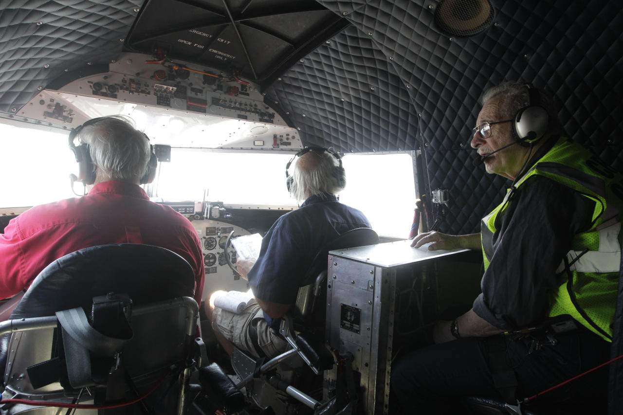 """Azriel """"Al"""" Blackman, right, flies in the cockpit of a DC-3, Wednesday, July 18, 2012 in New York. American Airlines is celebrating the 70-year service of a New York City mechanic who says he has no plans to retire. Azriel """"Al"""" Blackman was 16 years old when he started as an apprentice mechanic in July of 1942. (AP Photo/Mary Altaffer)"""
