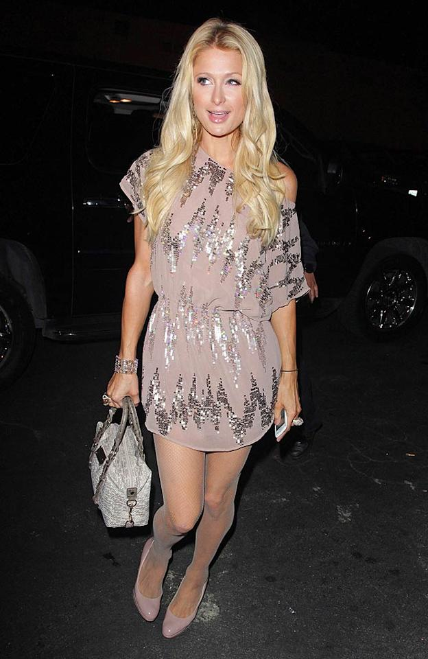 Speaking of sparkles, check out the super cute outfit Paris Hilton threw together for a recent night out on the town. The socialite perfectly paired her fab, off-the-shoulder frock with a crystal-encrusted cuff, along with heels and a handbag from her very own collection. (11/17/2011)