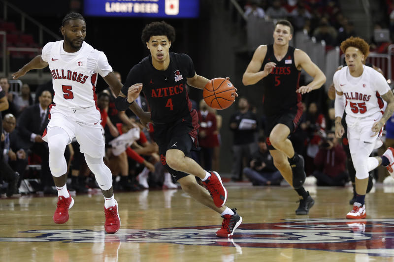 San Diego State's Trey Pulliam drives next to Fresno State's Jordan Campbell, left, during the first half of an NCAA college basketball game in Fresno, Calif., Tuesday Jan. 14, 2020. (AP Photo/Gary Trey Pulliam