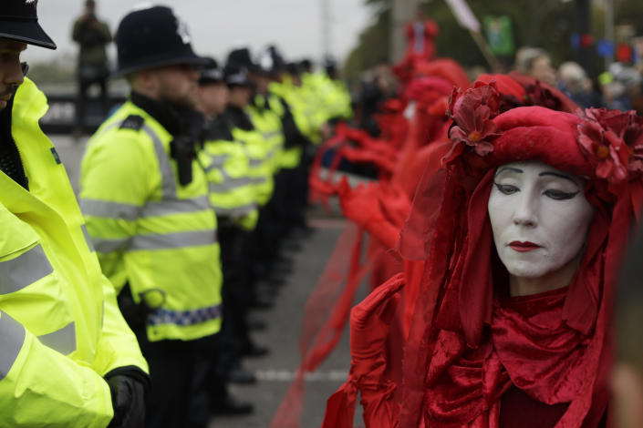 Environmental protestors face police on Lambeth bridge in central London Monday, Oct. 7, 2019. (Photo: Matt Dunham/AP)