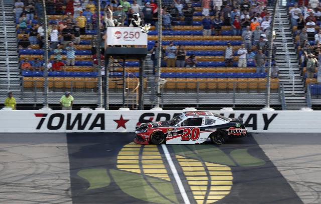 Christopher Bell crosses the finish line to win a NASCAR Xfinity Series auto race, Sunday, June 16, 2019, at Iowa Speedway in Newton, Iowa. (AP Photo/Charlie Neibergall)