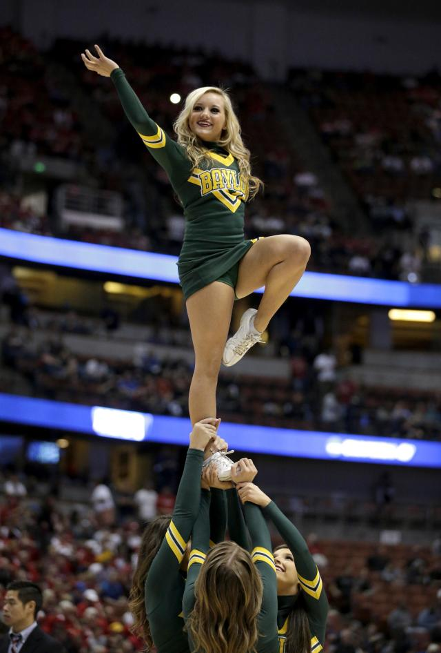 A Baylor cheerleader performs during a regional semifinal NCAA college basketball tournament game against Wisconsin, Thursday, March 27, 2014, in Anaheim, Calif. (AP Photo/Jae C. Hong)