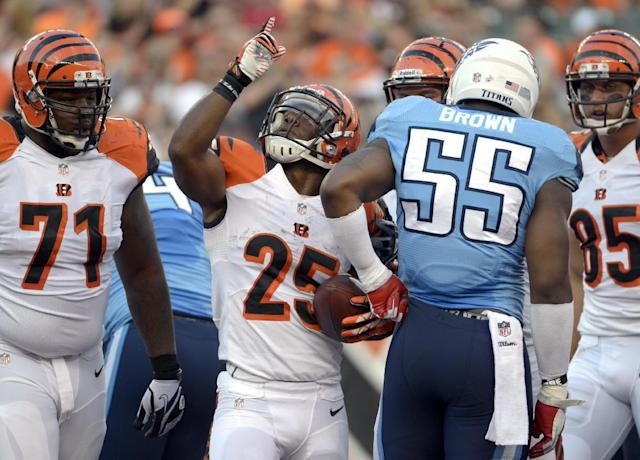 Cincinnati Bengals running back Giovani Bernard (25) points up after scoring a touchdown on a one-yard-run in the first half of an NFL preseason football game against the Tennessee Titans, Saturday, Aug. 17, 2013, in Cincinnati. (AP Photo/Michael Keating)