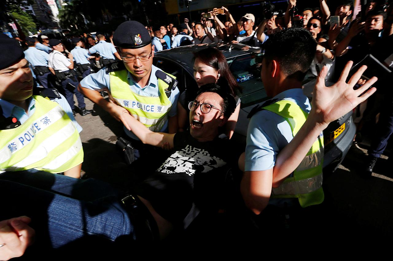 <p>Pro-democracy activist Avery Ng is detained by police as he takes part in a protest demanding the release of Chinese Nobel rights activist Liu Xiaobo, during Chinese President Xi Jinping's visit in Hong Kong, China, July 1, 2017. (Photo: Tyrone Siu/Reuters) </p>