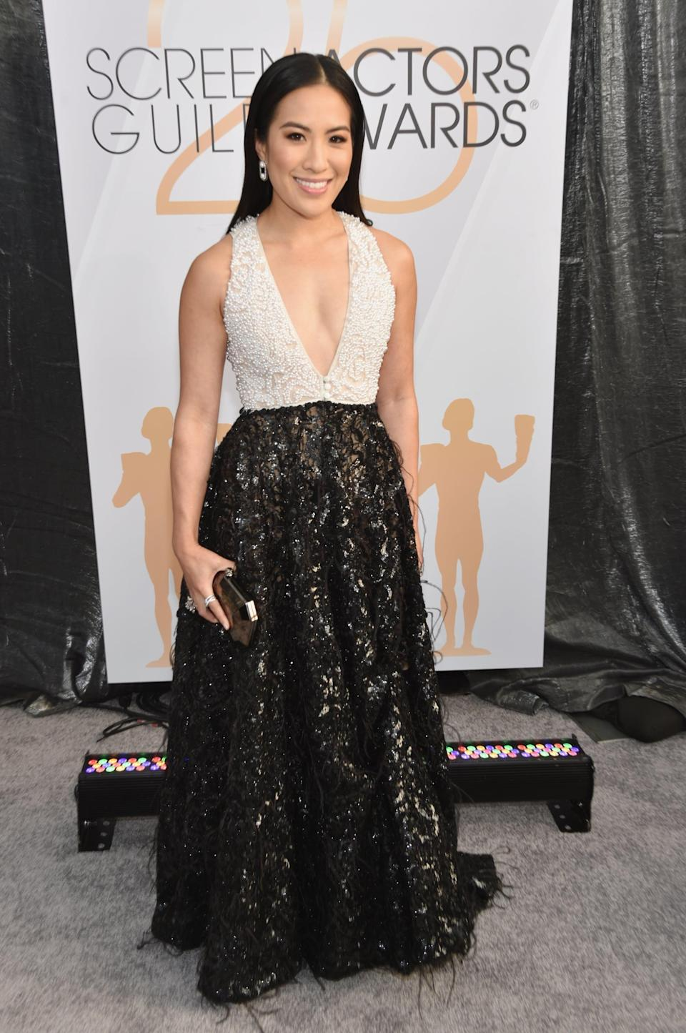 <p>Wearing a white and black gown by Thai Nguyen Atelier gown with Schutz heels.</p>