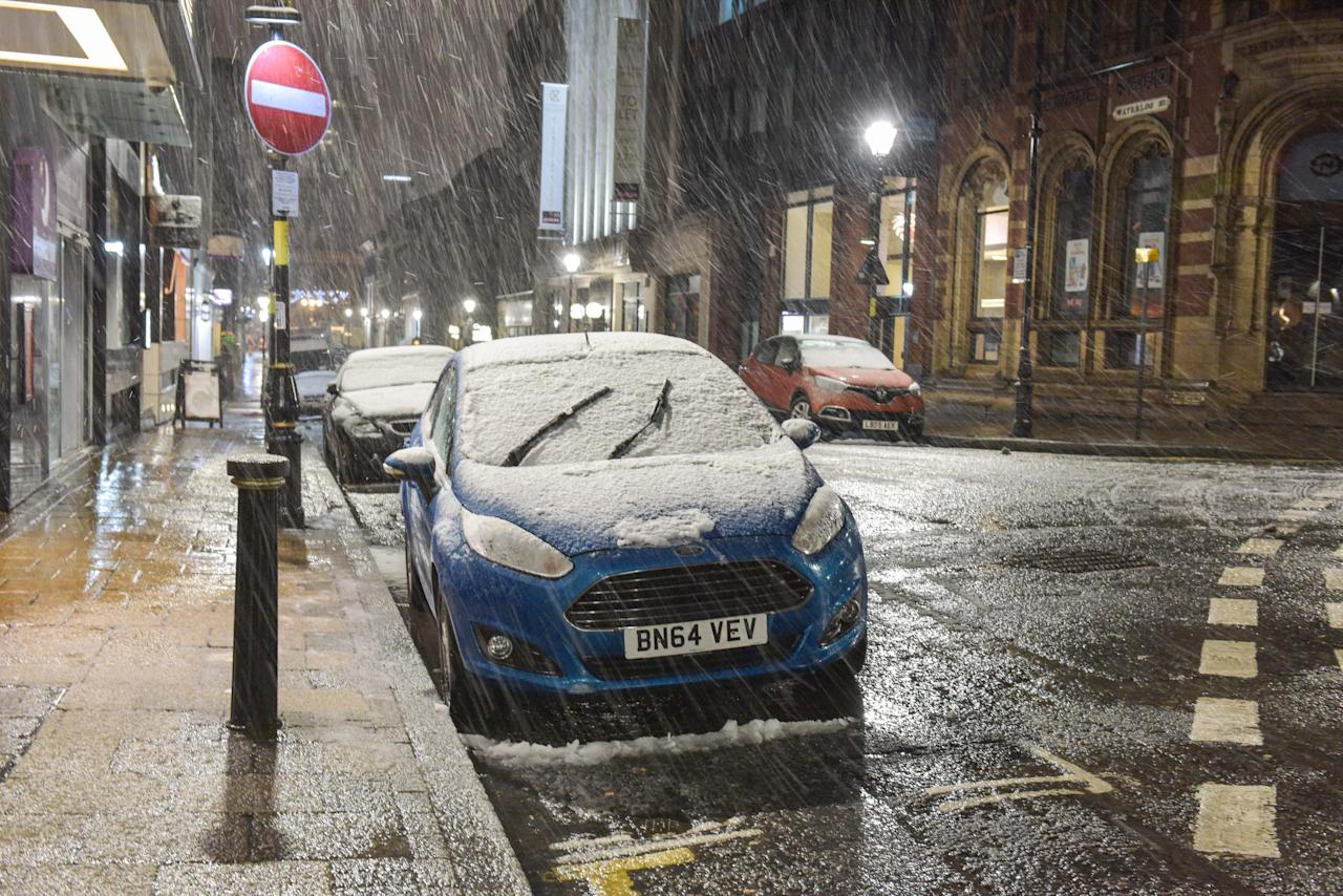 <p>Snow covered cars on Waterloo Street in Birmingham city centre. Heavy snow has hit Birmingham with blizzard conditions. The city had hours of rain beforehand meaning a lot is turning to slush but causing hazardous driving conditions. (Michael Scott/Caters News) </p>