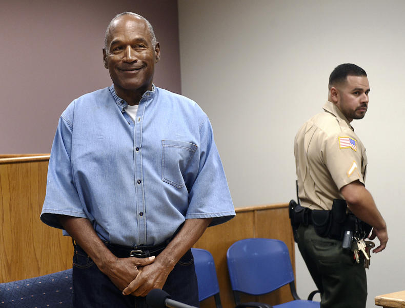 FILE - In this July 20, 2017, file photo, former NFL football star O.J. Simpson enters his parole hearing at the Lovelock Correctional Center in Lovelock, Nev. Simpson is suing a Las Vegas hotel-casino, alleging unnamed employees defamed him by telling celebrity news site TMZ he was ordered off the property in 2017 for being drunk, disruptive and unruly.