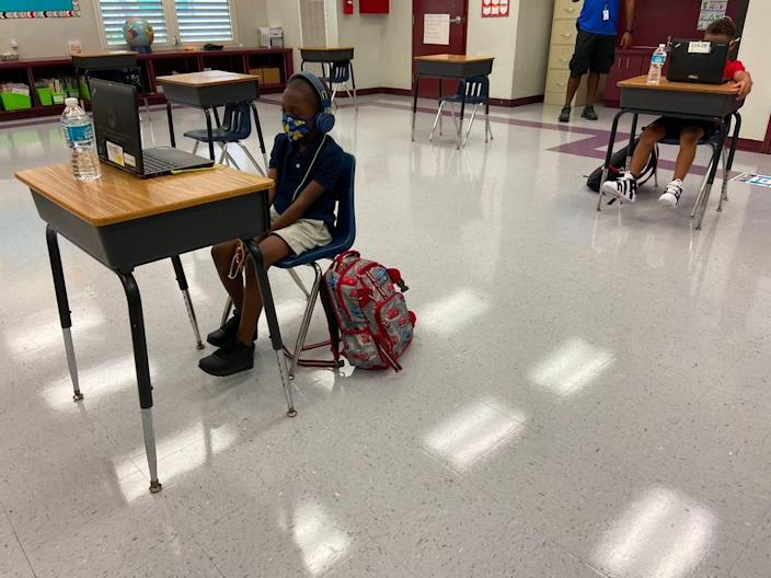Broward Estates Elementary School students sit at desks that are spaced apart during their first day back to face-to-face learning Friday, Oct. 9, 2020.