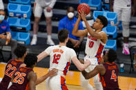 Florida guard Noah Locke (10) shoots against Virginia Tech in the second half of a first round game in the NCAA men's college basketball tournament at Hinkle Fieldhouse in Indianapolis, Friday, March 19, 2021. (AP Photo/Michael Conroy)