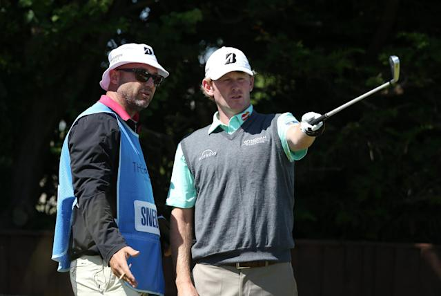 Brandt Snedeker of the US talks to his caddie before teeing off the 18th during a practice round ahead of the British Open Golf championship at the Royal Liverpool golf club, Hoylake, England, Tuesday July 15, 2014. The British Open starts on Thursday July 17. (AP Photo/Jon Super)